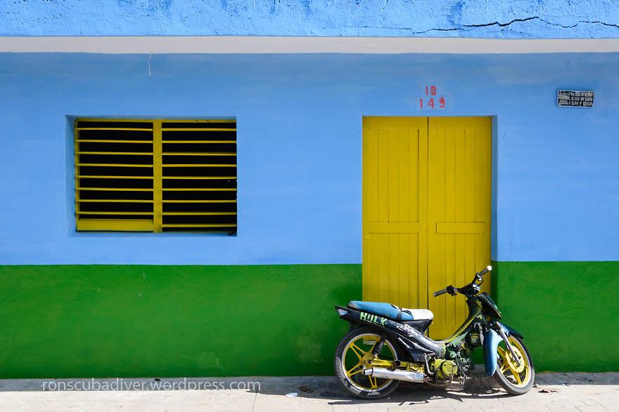 Moped and Yellow Door